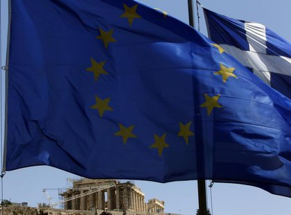 A European Union (E.U.) flag (front) and a Greek flag flutter in front of the monument of Parthenon on Acropolis hill in Athens June 17, 201