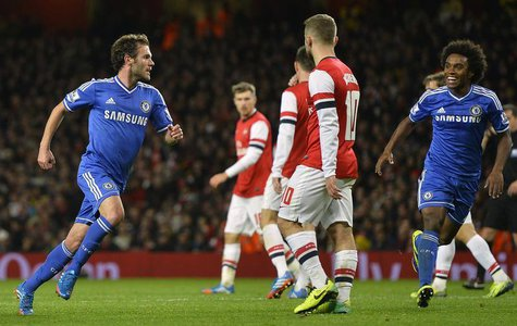 Chelsea's Juan Mata (L) celebrates scoring against Arsenal during their English League Cup fourth round soccer match at Emirates Stadium in