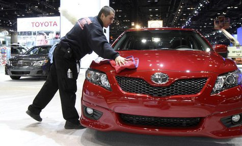 Luis Martinez cleans a Toyota Camry in preparation for the Chicago Auto Show February 9, 2010. REUTERS/John Gress