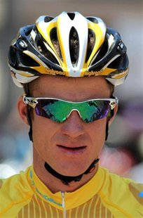 Michael Rogers sits wearing the leader's golden jersey at the start line for the eighth and final stage of the Tour of California cycling ra