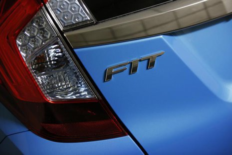 The Fit logo is seen on the body of a Honda Motor's Fit subcompact hybrid car at the company's headquarters in Tokyo October 30, 2013. REUTE
