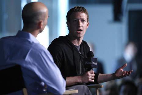 Facebook CEO Mark Zuckerberg (R) speaks during an onstage interview with James Bennet (L) of the Atlantic Magazine in Washington, September