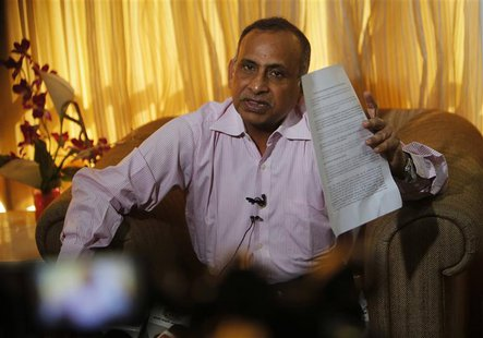Uttam Khobragade, father of Devyani Khobragade, India's deputy consul general in New York, speaks during a news conference in Mumbai Decembe