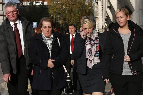 Family members of British soldier Lee Rigby leave during a lunch break in the trial of his suspected murderers at the Old Bailey in central