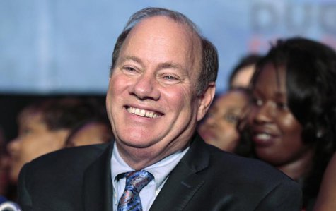 Detroit mayoral candidate Mike Duggan smiles as he addresses his supporters after being declared the projected winner on election day in Det