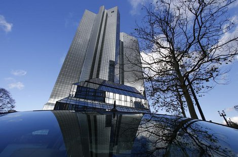 The headquarters of Deutsche Bank are mirrored in a rear window in Frankfurt October 29, 2013. REUTERS/Ralph Orlowski