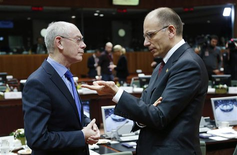 European Council President Herman Van Rompuy listens to Italy's Prime Minister Enrico Letta (R) during a European Union leaders summit in Br