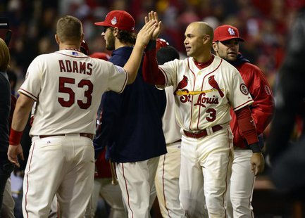 St. Louis Cardinals right fielder Carlos Beltran (3) celebrates with first baseman Matt Adams (53) after defeating the Boston Red Sox in gam