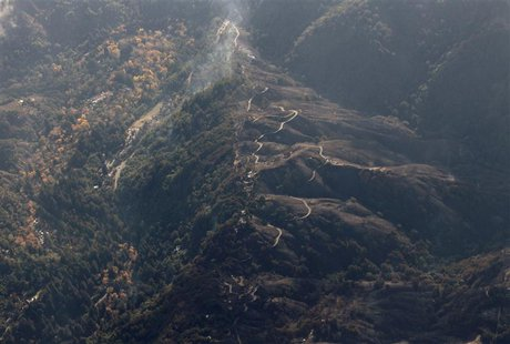 Aerial view shows a burned out area along Pfeiffer Ridge in Big Sur, California, December 19, 2013. REUTERS/Michael Fiala