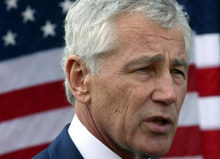 U.S. Secretary of Defense Chuck Hagel speaks to reporters at the Al Udeid Airbase, west of Doha December 10, 2013. REUTERS/Mark Wilson/Pool