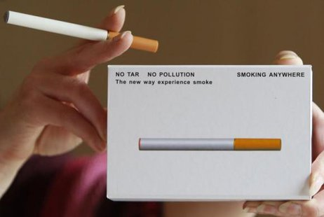 A woman displays a package of E-cigarette, an electronic substitute in the form of a rod, slightly longer than a normal cigarette, in Bordeaux, southwestern France, on March 25, 2008. CREDIT: REUTERS/REGIS DUVIGNAU