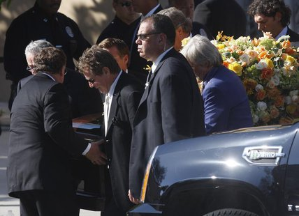 Actor Ryan O'Neal (3rd L) and other pallbearers carry the flower draped casket of late actress Farrah Fawcett after her funeral at the Cathe