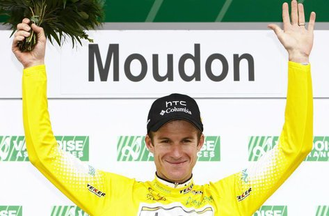 HTC Columbia's team rider Michael Rogers of Australia celebrates on the podium after wearing the leader's jersey during the third and time t