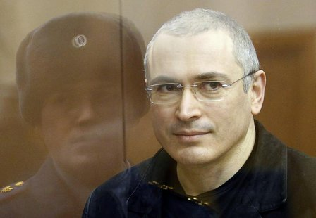 Jailed Russian former oil tycoon Mikhail Khodorkovsky stands in the defendants' cage before the start of a court session in Moscow December