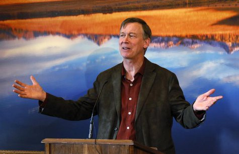 Colorado Governor John Hickenlooper lays out his plans for the next state legislative session at a news conference in his office at the Capi