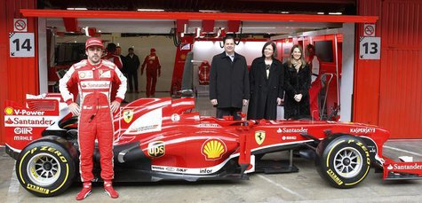Ferrari's Formula One driver Fernando Alonso of Spain poses in front of the new Ferrari F138 racing car during a training session at Circuit