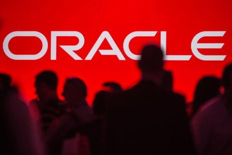 People gather prior to the start of a keynote speech at the All Things Oracle OpenWorld Summit in San Francisco, California September 24, 20