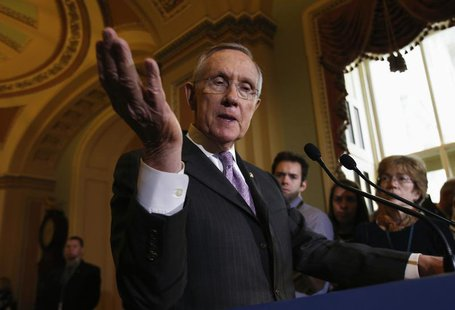 U.S. Senate Majority Leader Harry Reid (D-NV) gestures while speaking to the media following a Senate cloture vote on budget bill on Capitol
