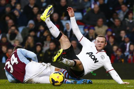 Aston Villa's Matthew Lowton (L) challenges Manchester United's Wayne Rooney during their English Premier League soccer match at Villa Park