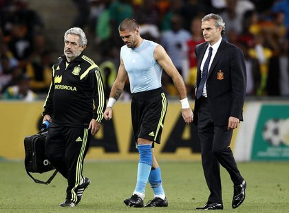 Spain's goalkeeper Victor Valdes (C) is escorted off the field during their international friendly soccer match against South Africa at Socc