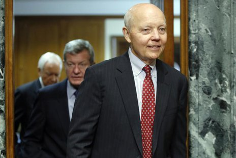 John Koskinen (R) returns from a break with Committee Chairman Senator Max Baucus (D-MT) (2nd L) and ranking member Orrin Hatch (R-UT) (L) t