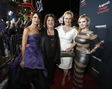 "Cast members (from L-R) Juliette Lewis, Margo Martindale, Meryl Streep and Abigail Breslin pose at the premiere of ""August: Osage County"" in"
