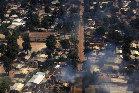 Smoke rises after homes were damaged in arson attacks in this aerial view of a neighbourhood in Central African Republic's capital Bangui De
