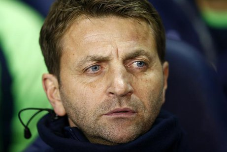 Tottenham Hotspur caretaker manager Tim Sherwood watches their English League Cup soccer match against West Ham United at White Hart Lane, L