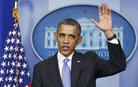 U.S. President Barack waves goodbye at the end of his year-end news conference in the White House briefing room in Washington, December 20,