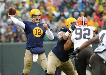 Green Bay Packers quarterback Aaron Rodgers (12) passes in the 1st quarter against the Cleveland Browns at Lambeau Field. Benny Sieu-USA TOD