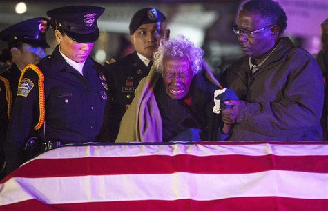 Clara Gantt, the 94-year-old widow of U.S. Army Sgt. Joseph Gantt, weeps in front of her her husband's casket after it was lowered from the