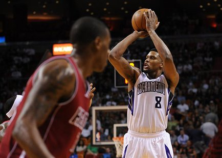 Dec 20, 2013; Miami, FL, USA; Sacramento Kings small forward Rudy Gay (8) shoots past Miami Heat point guard Mario Chalmers (15) during the