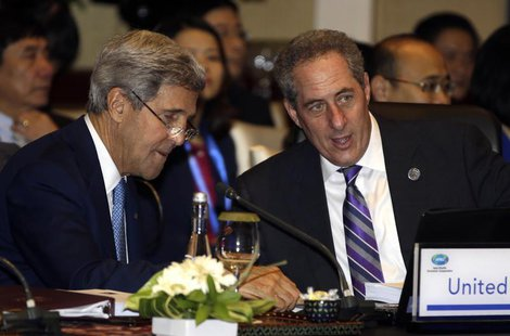 U.S. Secretary of State John Kerry (L) and U.S. Trade Representative Michael Froman talk prior to the Asia Pacific Economic Cooperation mini