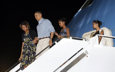 U.S. President Barack Obama (2nd L) and his family, (from L to R) Michelle Obama, Obama, Sasha and Malia, step from Air Force One upon their