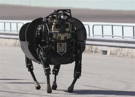 An LS 3 (Legged Squad Support System) robot demonstrates its movement, showing it is designed to accompany soldiers and Marines any place th