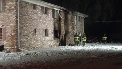 Appleton apartment building damaged by fire on Dec. 21, 2013. (Photo from FOX 11).