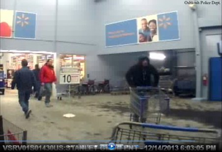 Still frame taken from surveillance video of a person believed to have stolen a Salvation Army red kettle from Walmart in Oshkosh, Dec. 14, 2013. (Photo from the Oshkosh Police Department)