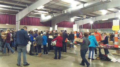 Volunteers grab boxes and fill them with assorted donated goods and then walk around a big ring of tables and drop them off at the appropriate stations.  Eventually tons of food get sorted.
