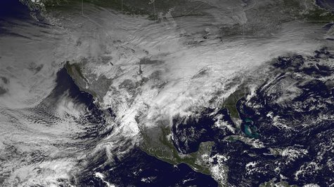 A storm system moving across the United States is pictured in this NASA handout satellite photo taken December 20, 2013. REUTERS/NASA/Handou