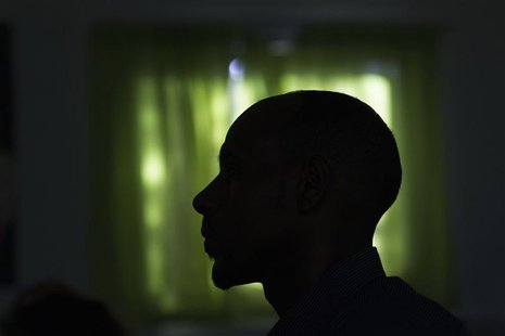 Angesom Solomon, a 28-year-old African migrant from Eritrea, is silhouetted as he attends a first-grade Hebrew lesson at Kehila Democratic s