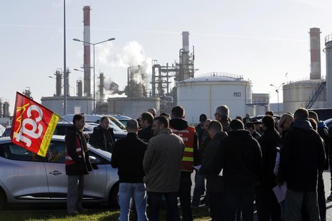Striking union workers of French oil giant Total gather in front of the oil refinery of Donges, near Nantes, December 20, 2013. REUTERS/Step
