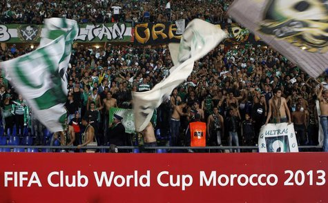 Raja Casablanca's fans celebrate winning their FIFA Club World Cup semi-final soccer match against Atletico Mineiro at Marrakech stadium Dec