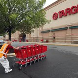 A Target employee returns carts to the store in Falls Church, Virginia May 14, 2012. REUTERS/Kevin Lamarque