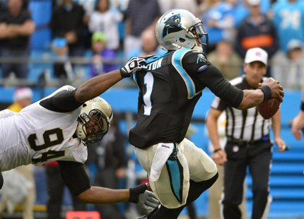 Dec 22, 2013; Charlotte, NC, USA; Carolina Panthers quarterback Cam Newton (1) is sacked by New Orleans Saints defensive end Cameron Jordan
