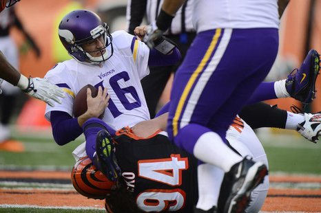 Dec 22, 2013; Cincinnati, OH, USA;Minnesota Vikings quarterback Matt Cassel (16) sacked by Cincinnati Bengals defensive tackle Domata Peko (