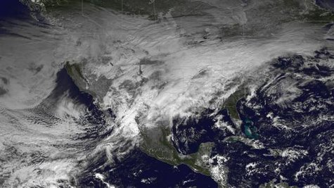 A storm system moving across the United States is pictured in this NASA handout satellite photo taken December 20, 2013.  Credit: Reuters/NASA/Handout