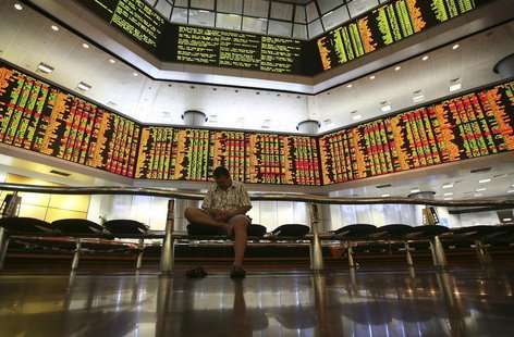 A man rests inside a stock exchange in Kuala Lumpur December 19, 2013. REUTERS/Samsul Said