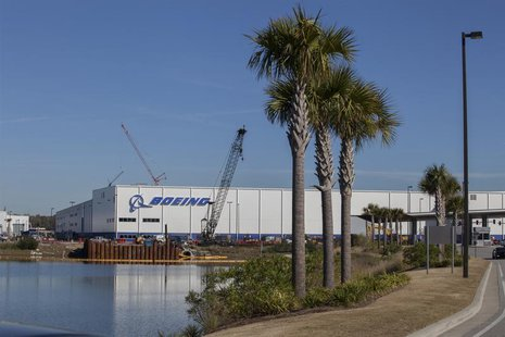 Construction cranes and palm trees line the entrance at South Carolina Boeing in North Charleston, South Carolina December 19, 2013. REUTERS