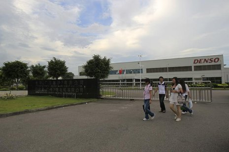 Employees walk outside of the Denso (Guangzhou Nansha) Co Ltd plant in Nansha, Guangdong province June 22, 2010. REUTERS/Tyrone Siu