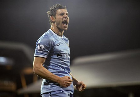 Manchester City's James Milner celebrates his goal against Fulham during their English Premier League soccer match at Craven Cottage in Lond